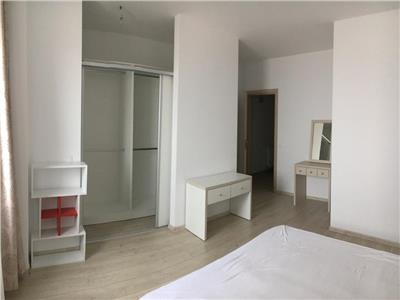 de inchiriat apartament cu 3 camere, 110 mp, decomandat, cu 3 locuri de parcare subteran
